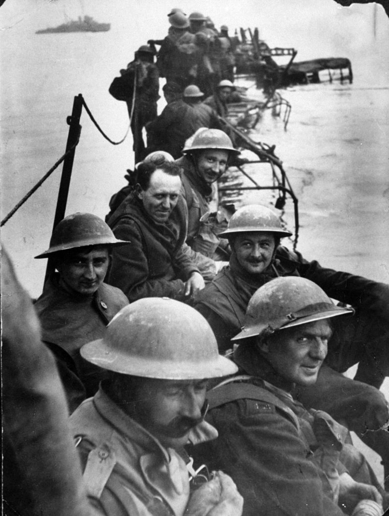 Members of Royal Ulster Rifles waiting on improvised pier of lorries to evacuate Dunkirk during low tide. (Photo by Time Life Pictures/Pictures Inc./The LIFE Picture Collection/Getty Images)