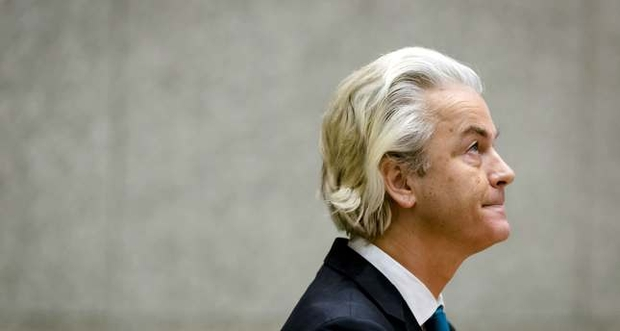 Dutch right-wing Freedom Party politician Geert Wilders speaks during a debate about the attacks in Paris in The Hague on November 19, 2015. Wilders demanded that Dutch borders be closed and suspect individuals be locked down to prevent them from carrying out attacks. AFP PHOTO / ANP / BART MAAT --NETHERLANDS OUT--